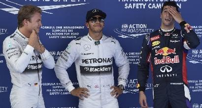 Lewis Hamilton con Rosberg e Ricciardo (Afp)