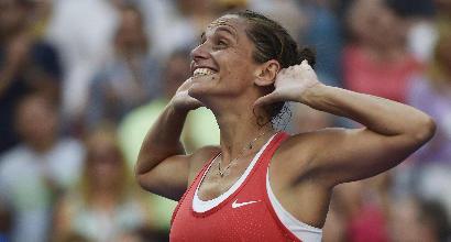 Tennis, Vinci derubata. Ma ritrova il sorriso